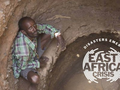 East Africa Crisis: Bukayo Molu waiting inside a hand dugout well for the water level to slowly rise © David Mutua, CAFOD/Caritas Marsabit