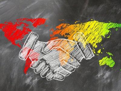 shaking-hands over globe